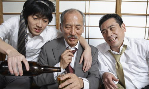 Three Businessmen at Party --- Image by © Tokyo Space Club/Corbis