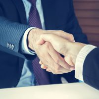 Handshake of businessmen in vintage tone - greeting , dealing, merger and acquisition concepts
