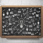 Finance concept: Chalk White Light Bulb icon on School Board background with  Hand Drawn Business Icons