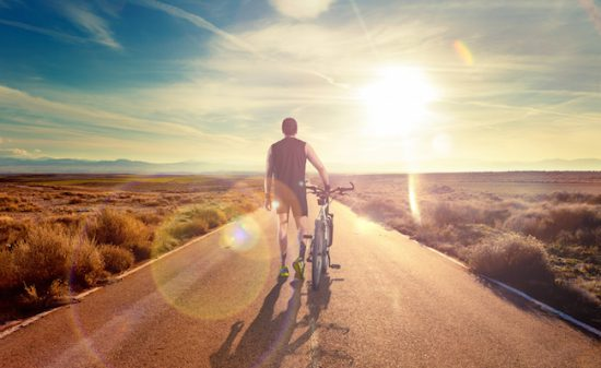 Bike and adventures lifestyle.Bicycle rider and road scenic