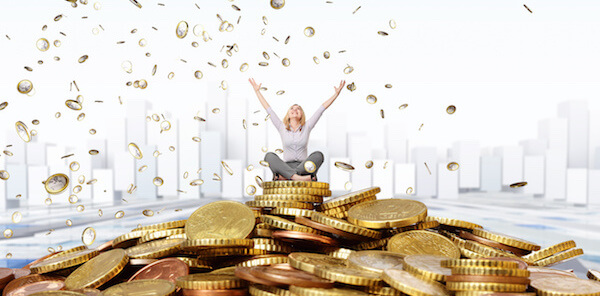 happy_woman_with_gold_coins_Dollarphotoclub_44994187